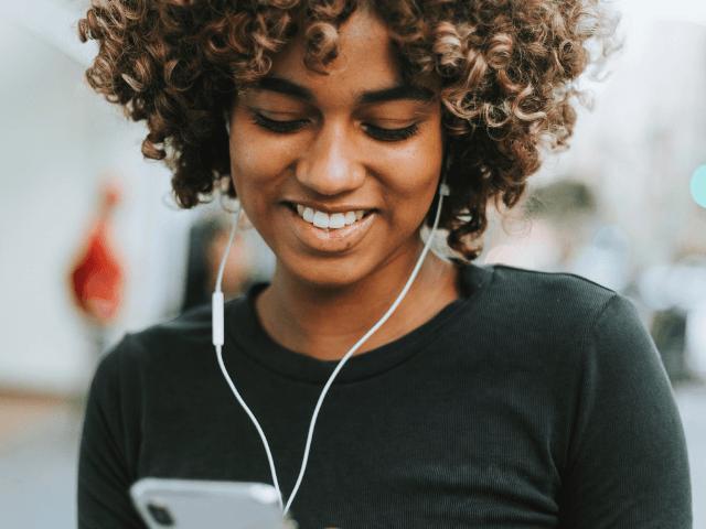 Benefits of Blog black woman looking at phone