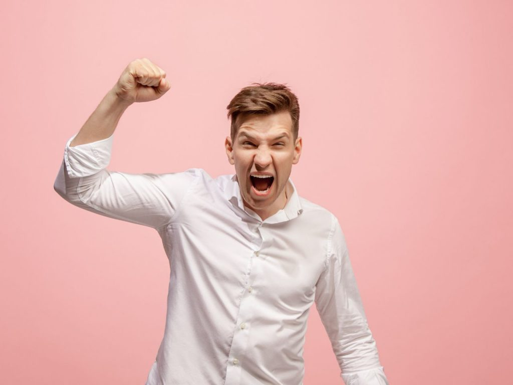 Benefits of Blogging Man Angry white shirt pink background
