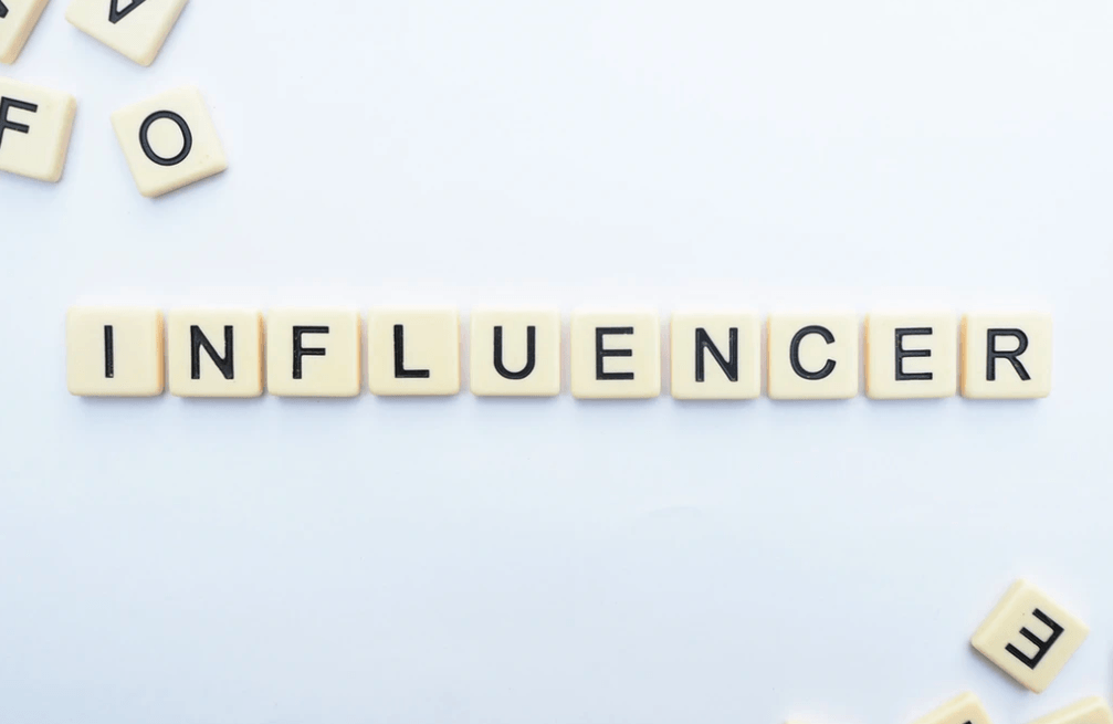 21 Ways to Repurpose Content with Influencer word spelled out in Scrabble blocks.
