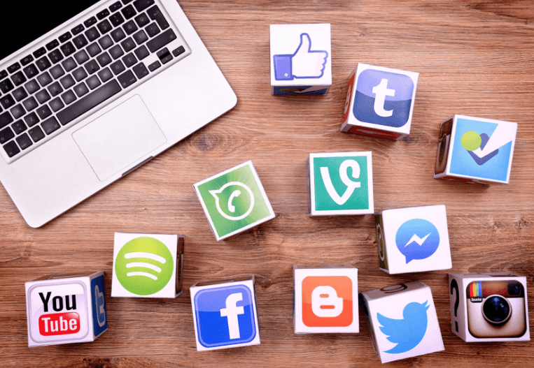 21 Ways to Repurpose Content with social media logos on top of blocks.