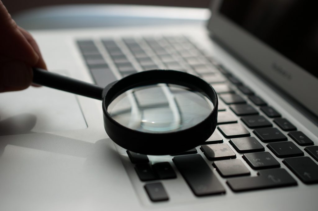 Keyword research and analysis with black magnifying glass